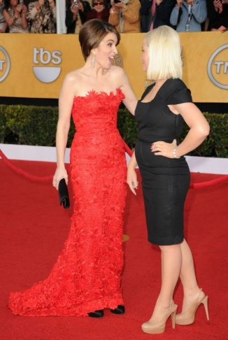 Tina Fey and Amy Poehler arrive at the 13th Annual Warner Bros. And InStyle Golden Globe Awards After Party at The Beverly Hilton hotel on January 15, 2012 in Beverly Hills.