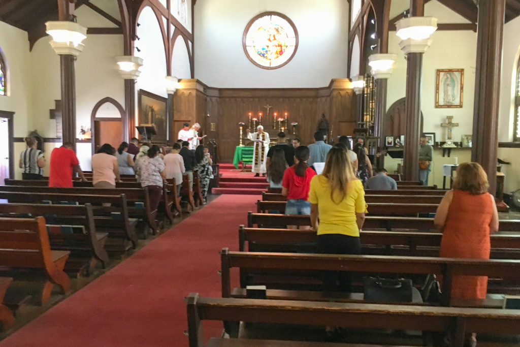 Congregants at the Episcopal Church of the Epiphany in Lincoln Heights celebrate Sunday service on the morning that immigration sweeps were supposed to begin.