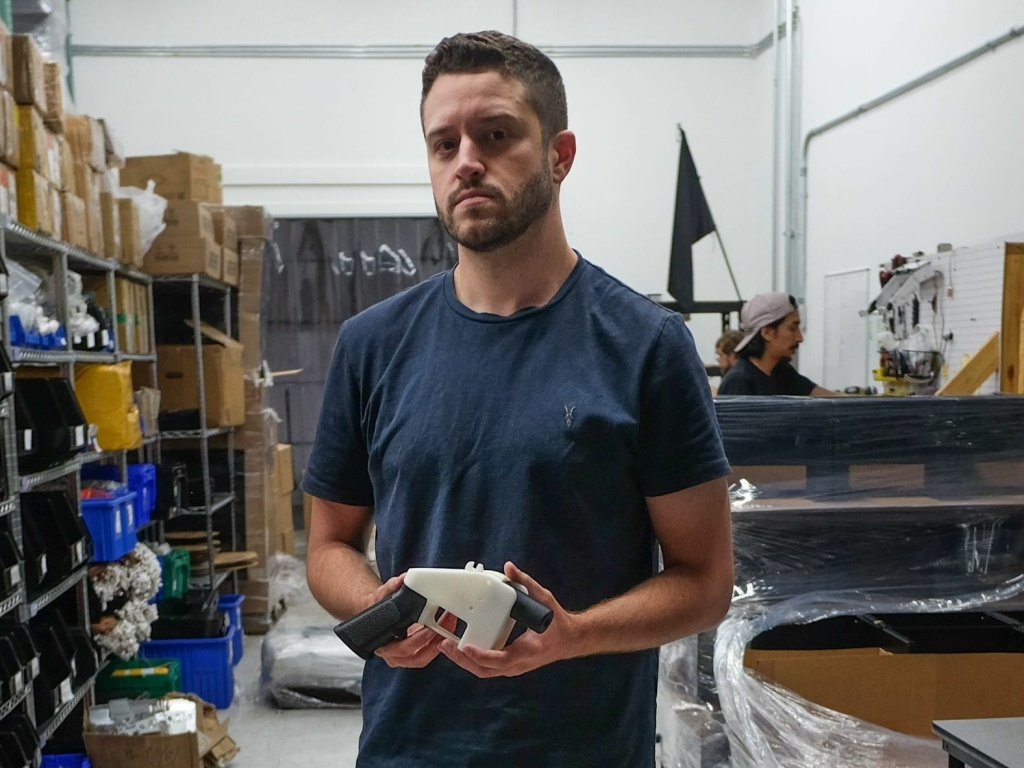 Cody Wilson, owner of Defense Distributed, holds a 3D printed gun, called the