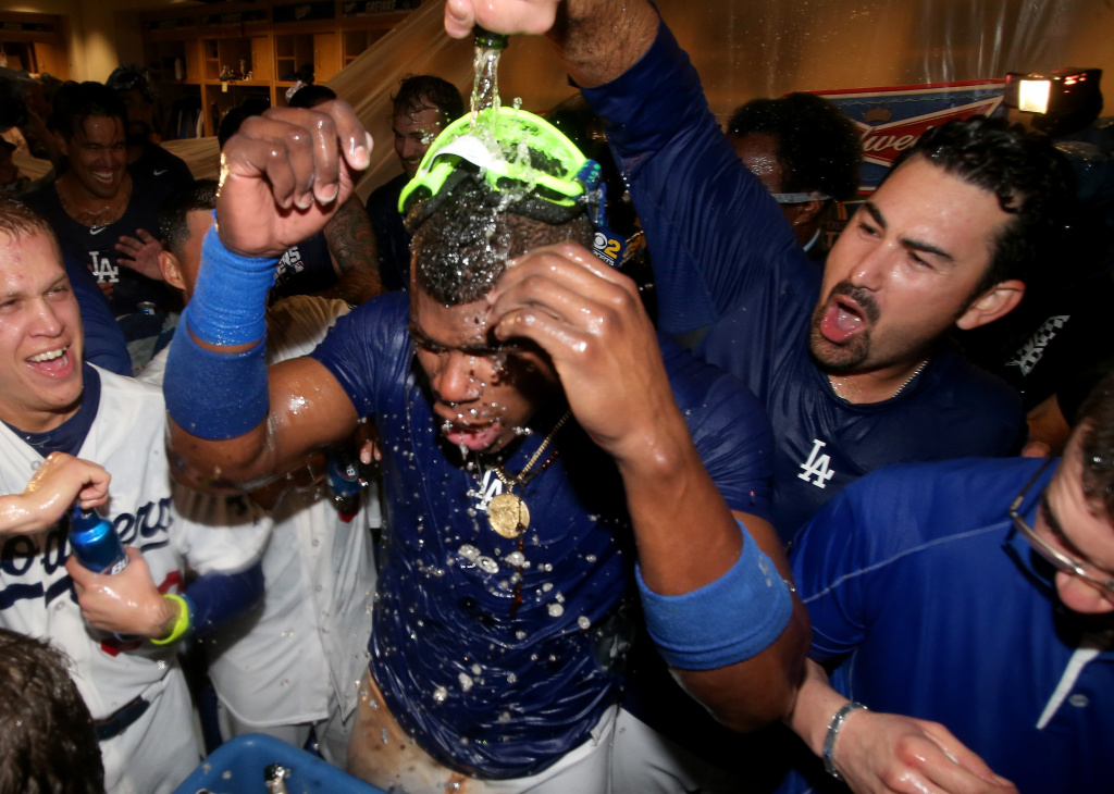 Yasiel Puig #66 and Adrian Gonzalez #23 of the Los Angeles Dodgers celebrate in the locker room after the Dodgers defeat the Atlanta Braves 4-3 in Game Four of the National League Division Series at Dodger Stadium on October 7, 2013 in Los Angeles, California.