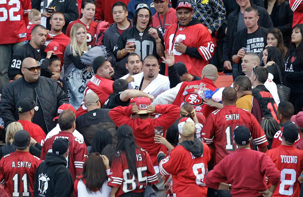 In this Aug. 20, 2011 photo, football fans fight in the stands during a preseason NFL football game between the San Francisco 49ers and the Oakland Raiders in San Francisco. After two men were shot and wounded following the preseason game, the NFL and the mayors of the two cities jointly called for an end to