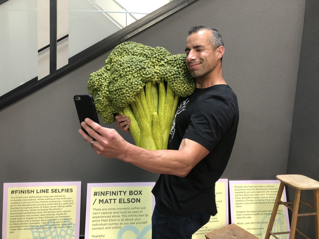 Food selfies are a big part of the selfie culture. A Martinez takes a selfie with some cuddly broccoli.
