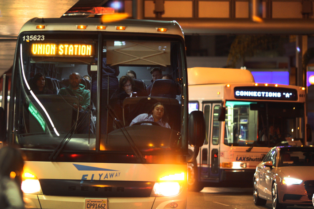 Buses pick up arriving travelers at LAX as people travel to Thanksgiving holiday destinations on November 26, 2014 in Los Angeles, California.