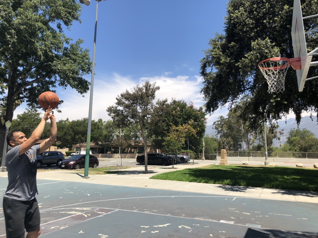 Raymond Pecson takes a shot at a park in East Pasadena, where the air quality is unhealthy for sensitive groups.