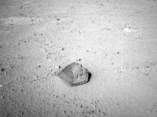 The drive by NASA's Mars rover Curiosity during the mission's 43rd Martian day, or sol, (Sept. 19, 2012) ended with this rock about 8 feet (2.5 meters) in front of the rover. The rock is about 10 inches (25 centimeters) tall and 16 inches (40 centimeters) wide.