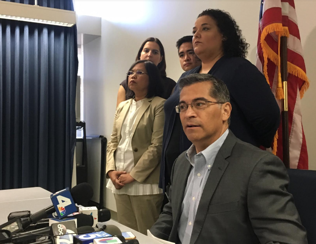 California State Attorney General Xavier Becerra responds to reporters' questions on Tuesday, Sept. 12, 2017, in downtown Los Angeles. Becerra met with local immigrant advocates to discuss next steps in the defense of the Deferred Action for Childhood Arrivals program, known as DACA. The Trump administration announced last week that it will end the program in March.