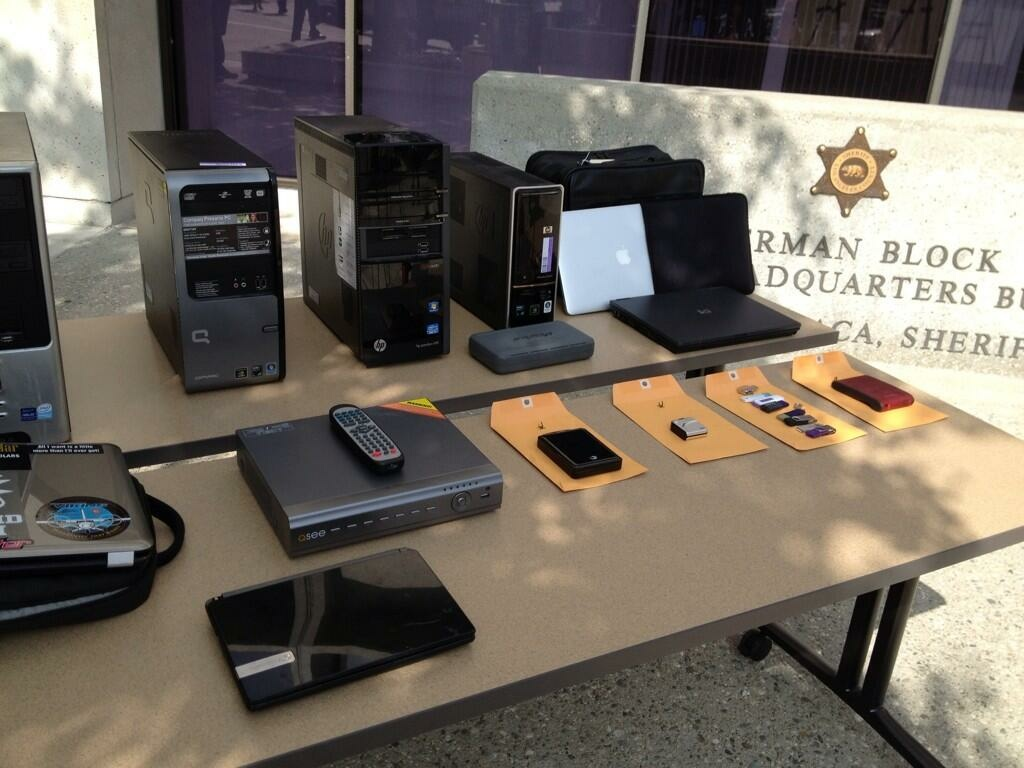 The Los Angeles County Cyber Crimes Task Force on Oct. 25, 2013, displayed evidence seized as part of a six-week investigation that culminated in the arrest of five suspects in connection with a case involving the possession and distribution of child pornography over the Internet.