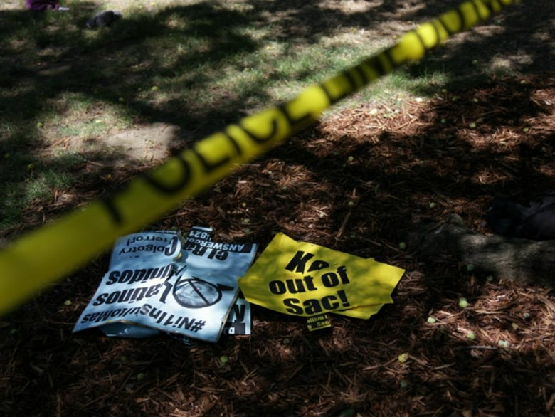 Police tape and protest signs at the state Capitol on Sunday, June 26, 2016, after violent clashes broke out between demonstrators and counter-protestors during a right-wing extremist rally.