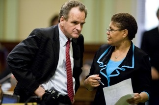 California State Assembly Republican leader Sam Blakeslee (R-San Luis Obispo) and Speaker Karen Bass (D-Los Angeles) work to finalize a solution to the state's budget problem on July 24, 2009 in Sacramento. Bass now heads to the nation's capital as one of California's two new members to Congress. The other is Republican Jeff Denham from Fresno.