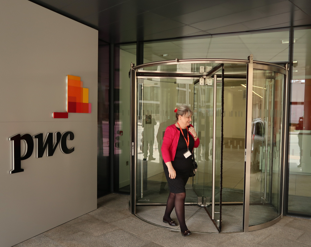 A person passes the offices of PricewaterhouseCoopers (PwC) in St Helier on April 12, 2017 in St Helier, Jersey.
