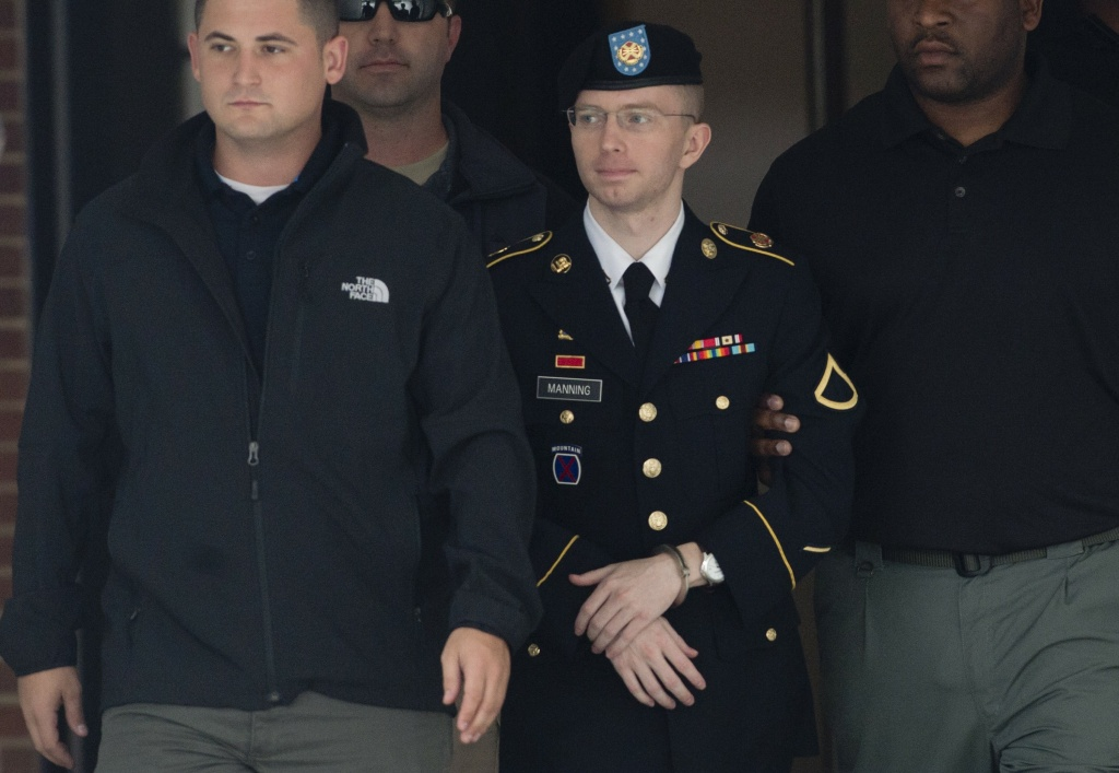 US Army Private First Class Bradley Manning departs a US military court facility at Fort Meade, Maryland on August 20, 2013.
