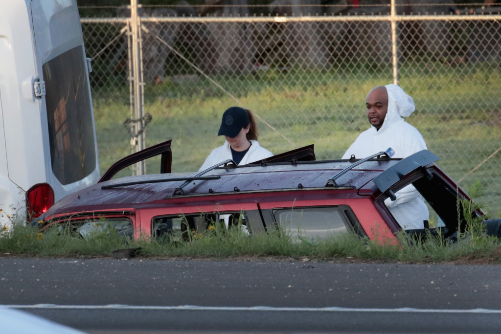 Law enforcement officials search for evidence at the location where the suspected package bomber was killed in suburban Austin on March 21, 2018 in Round Rock, Texas. Mark Anthony Conditt, the 24-year-old suspect, blew himself up inside his vehicle as police approached to take him into custody.