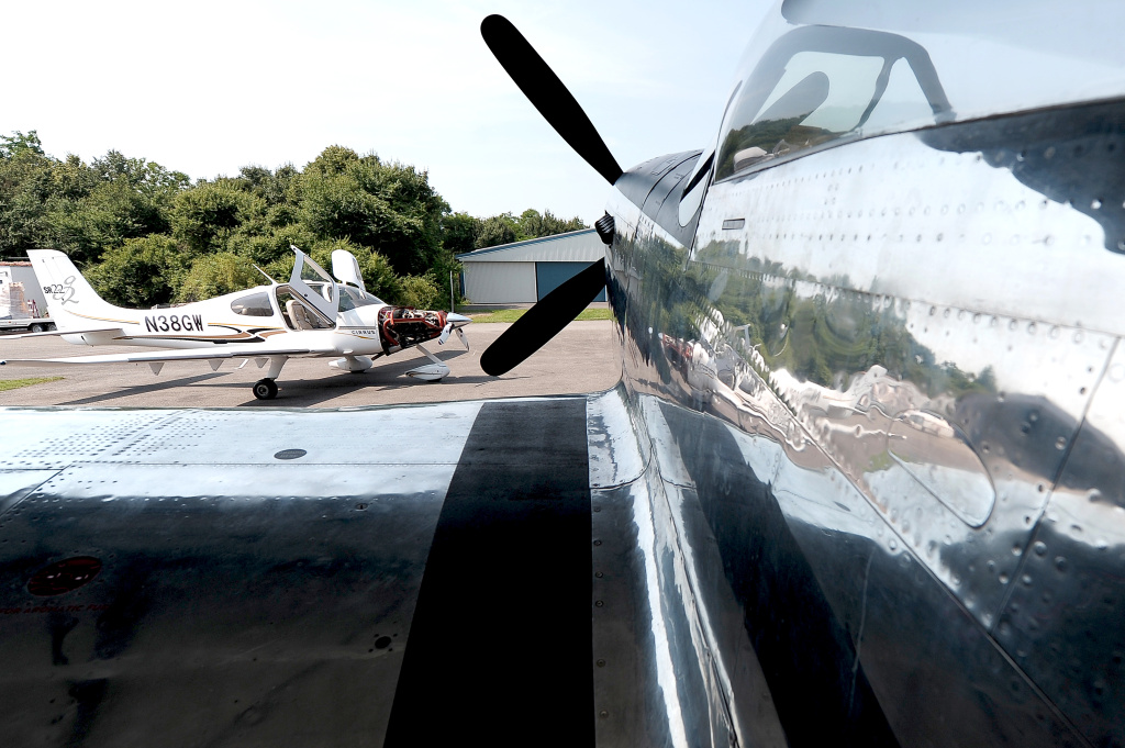 A Cirrus SR22 plane (left) and a P-51D Mustang plane are seen in the Meiermotors company workshop in Eschbach, Germany on July 9, 2013.