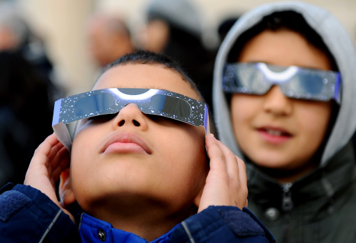 Children wear special glasses as they wa