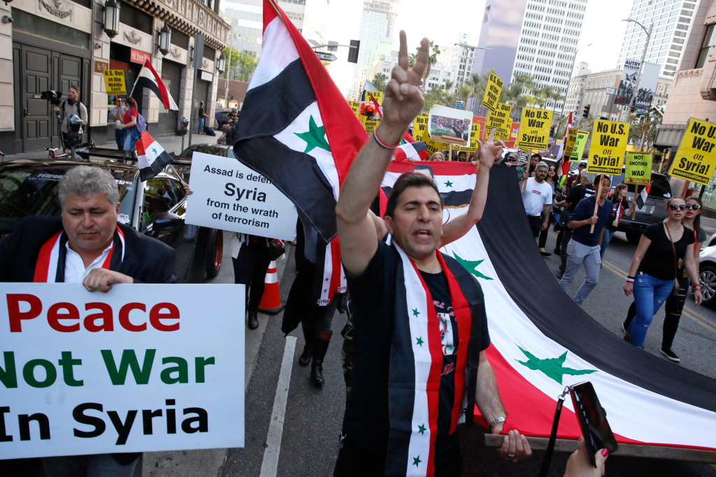 Syrian-Americans express their anger at the missile strike on their homeland, during an anti-war rally opposing the military strikes by western countries in Syria, in downtown Los Angeles Saturday, April 14, 2018. On Saturday, those commemorating Syria's independence from France in 1946, called the missile strikes by the U.S., Britain and France illegal.
