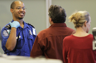 A TSA agent waits for approval to release travelers as they go through airport security at the screening area of the Richmond International airport in Richmond, Va., Tuesday, Nov. 23, 2010. The Obama administration's top transportation security official on Monday urged passengers angry over safety procedures not to boycott airport body scans.