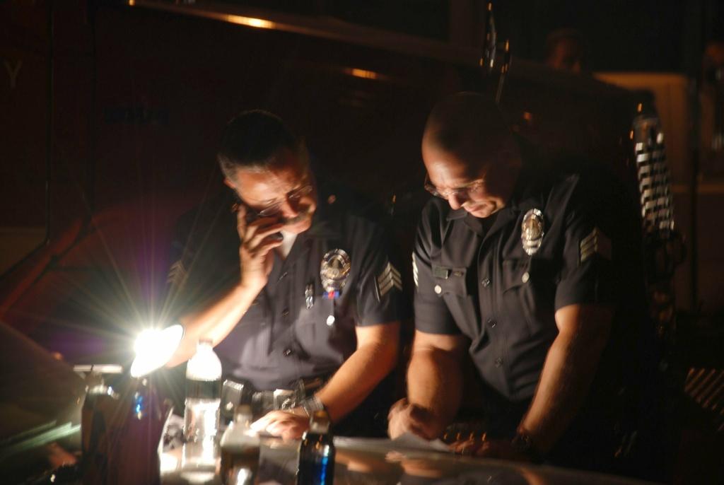 Police officers undergo an investigation on September 13, 2008.