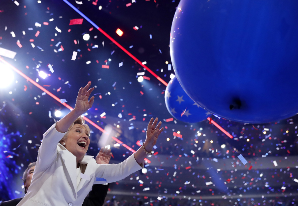 Democratic presidential nominee Hillary Clinton reacts as balloons and confetti fall after addressing the delegates during the final day of the Democratic National Convention in Philadelphia, Thursday, July 28, 2016. (AP Photo/Carolyn Kaster)