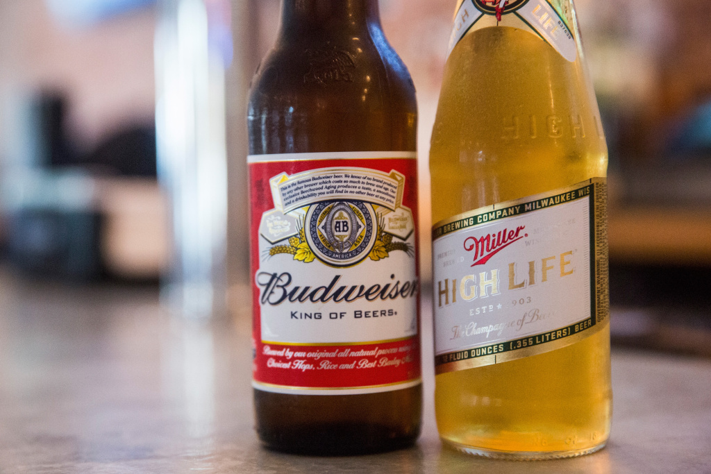 SABMiller accepted in principle an improved takeover bid from Anheuser Busch InBev, which along with Budweiser makes Corona, Stella Artois and Beck's.