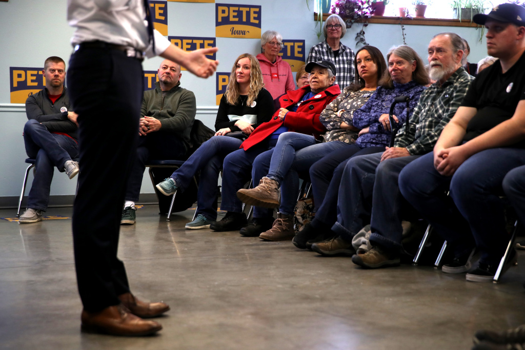 Voters look on as Democratic presidential candidate former South Bend, Indiana Mayor Pete Buttigieg speaks during a campaign event on January 29, 2020 in Webster City, Iowa.