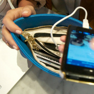 One of Edwards' emPOWERED bags charging an iPhone
