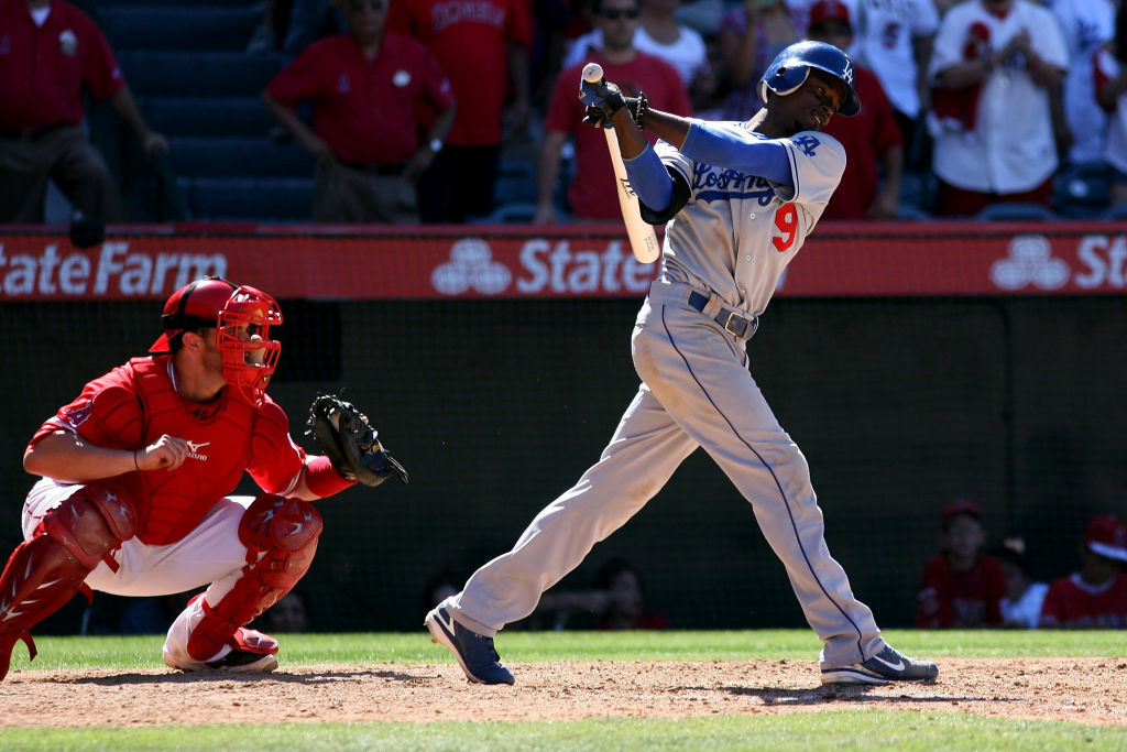 Dee Gordon #9 of the Los Angeles Dodgers strikes out swinging to end the interleague game as catcher Bobby Wilson #46 of the Los Angeles Angels of Anaheim gloves the ball at Angel Stadium of Anaheim on June 24, 2012 in Anaheim, California.  The Angels won 5-3.