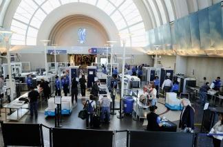 Transportation Security Administration (TSA) agents screen passengers at Los Angeles International Airport.