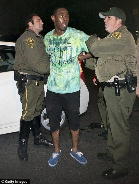 Tyler the Creator being arrested outside the Roxy in West Hollywood after he allegedly vandalized the club's sound board.