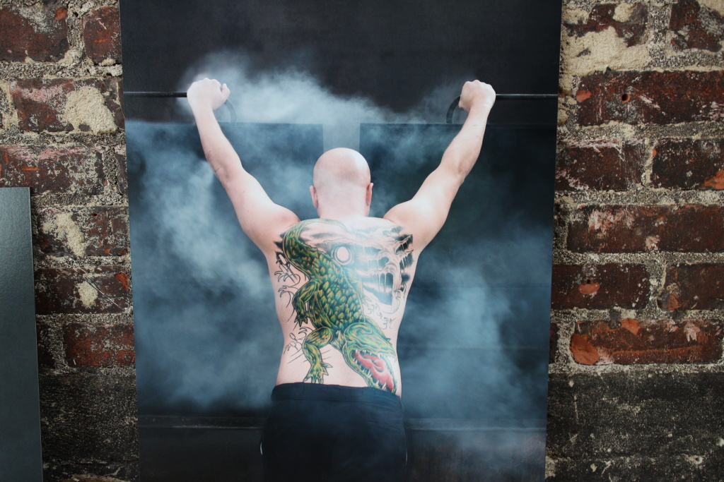 A photo of New Orleans Chef Isaac Toups from the Pacific Food and Beverage Museum's Shakers, Knives, and Irons exhibit, featuring images from photographer Romney Caruso.