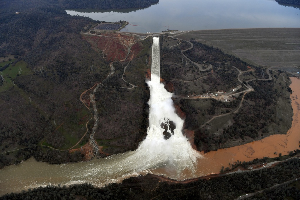 The Oroville Dam spillway releases 100,000 cubic feet of water per second down the main spillway in Oroville, California on February 13, 2017.