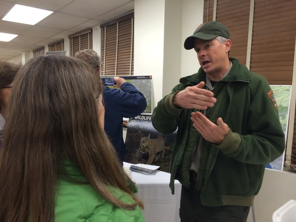 National Park Service biologist Jeff Sikich explains his work studying mountain lions at a recent public meeting for a proposed wildlife crossing in Agoura Hills.