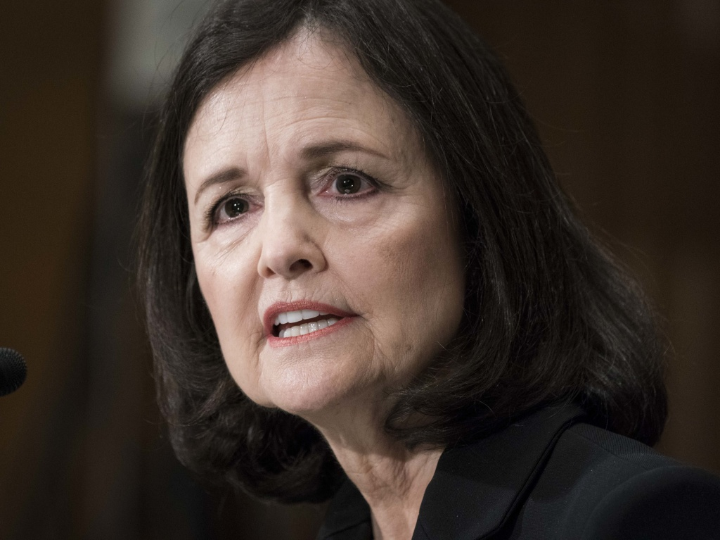 Judy Shelton testifies before the Senate Banking, Housing and Urban Affairs Committee during a hearing on her nomination to the Federal Reserve Board of Governors on Feb. 13, 2020. Shelton is set to be confirmed by a slim majority in the Senate this week.