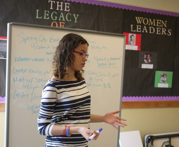 A student takes notes at the white board during a recent Purple Group meeting.