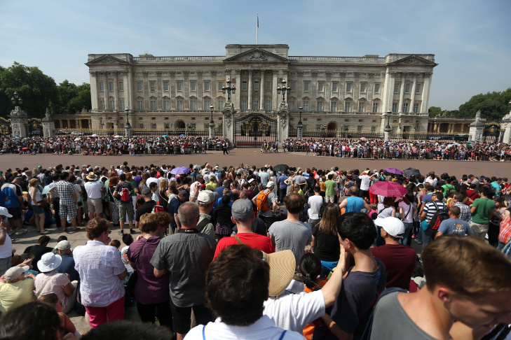 Crowds wait outside Buckingham Palace on July 22, 2013 in London, England. Clarence House have announced that the Duchess of Cambridge, Kate Middleton, has arrived at St Mary's Hospital in west London where she is expected to give birth.