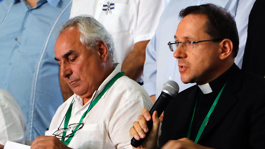 Nicaragua's Apostolic Nuncio Waldemar Sommertag speaks next to the OAS special envoy Luis Ángel Rosadilla during a news conference in Managua on Wednesday. They said the government had agreed to release detainees within 90 days.