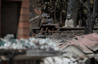 File photo: A charred buddah statue sits in the yard of a home that was destroyed by fire following a deadly gas main explosion on September 13, 2010 in San Bruno, California.