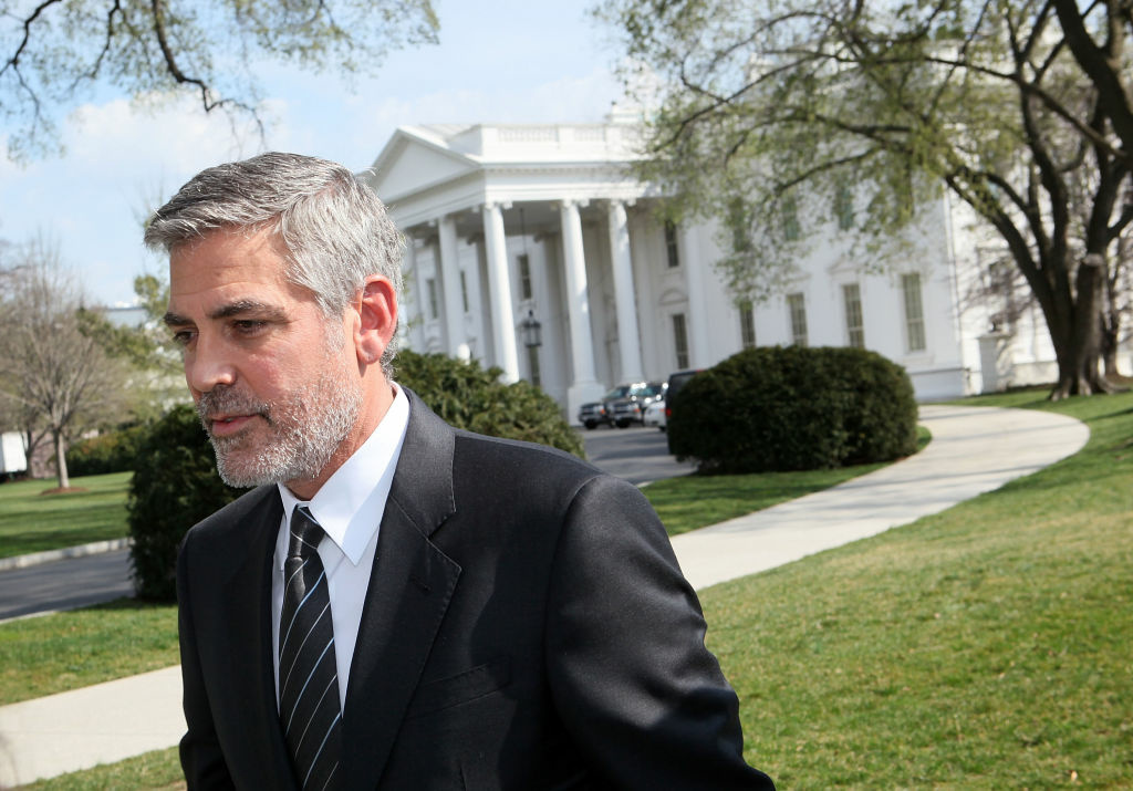 Actor George Clooney leaves after he spoke to the media March 15, 2012 at the White House in Washington, DC. Clooney had meeting with President Barack Obama to discuss the current situations in Darfur, Sudan.