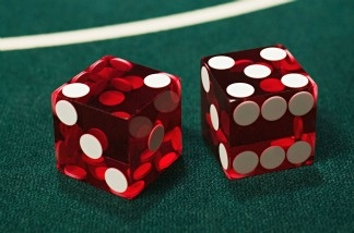 A pair of dice on a craps table.