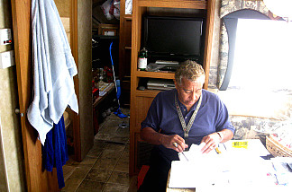 After the fire, Gary Rivera thought he would live in his rental trailer for four months.  He's been there for 13 months, and he's still unsure of when his claim will be resolved.
