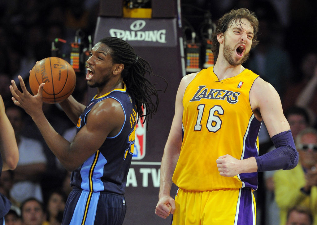 Los Angeles Lakers forward Pau Gasol, right, of Spain reacts after scoring as Denver Nuggets forward Kenneth Faried reacts as well during the second half in Game 7 in their first-round NBA basketball playoff series, Saturday, May 12, 2012, in Los Angeles. The Lakers won 96-87. (AP Photo/Mark J. Terrill)