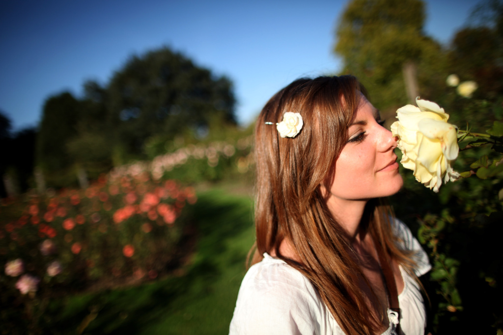 Helen Mitchell, 24, from Newcastle smells a rose in a garden in Regents Park on September 27, 2011 in London, England.