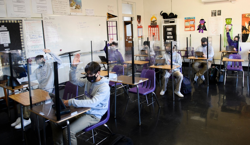 Students attend an in-person English class at St. Anthony Catholic High School during the Covid-19 pandemic on March 24, 2021 in Long Beach, California.