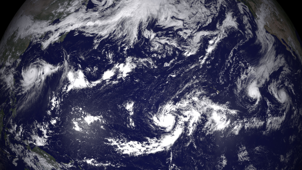 In this handout provided by the National Oceanic and Atmospheric Administration (NOAA) from the GOES-East satellite, four separate weather system  (L-R) Halong, Genevieve, Iselle, and Julio are tracked in the Pacific Ocean off the west coast of the United States.