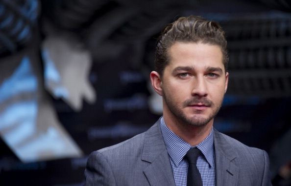 US actor Shia Labeouf poses for photographers as he arrives for the European premiere of US film Transformers 3 in Berlin June 25, 2011.