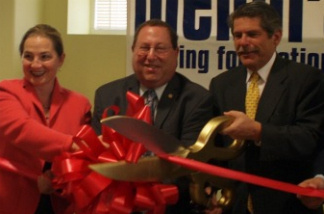 The giant pair of ribbon cutting scissors at a ceremony.