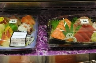 A sign stands informs customers that the seafood contained in the sushi and sashimi for sale is not of Japanese origin, at a supermarket in Hong Kong on March 19, 2011.