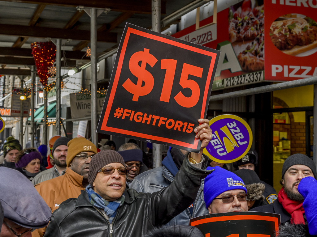 People protest for a $15 minimum wage in New York City in 2017.