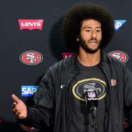 Colin Kaepernick of the San Francisco 49ers speaks to media. Kaepernick recently sparked controversy for kneeling during the national anthem.