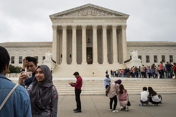 People take photographs outside the U.S. Supreme Court, October 11, 2017 in Washington, DC.