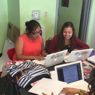 Two 12th graders, Ana Castro (left) and Natalie Valdovinos, work on their college applications at an after-school applications party organized by their public school, the UCLA Community School in LA's Koreatown.